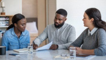 Couple sitting at table with a financial advisor