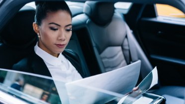 Person reading a report inside a vehicle