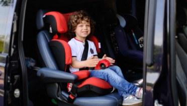 Child in a booster seat in a minivan