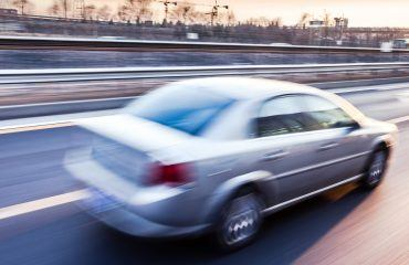 Car driving on a highway with a blur effect