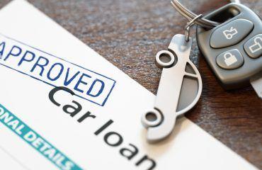 Car keys above a loan application