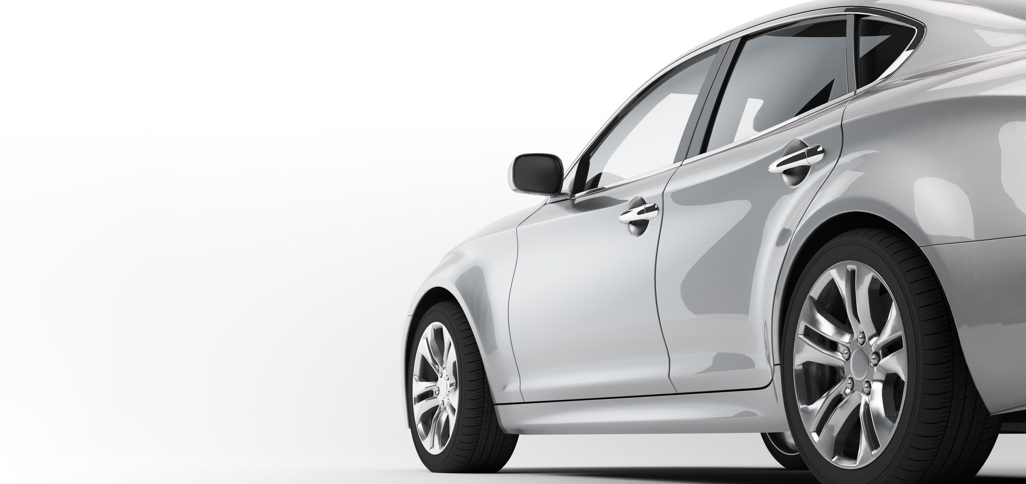 Side view of a parked sedan on white background