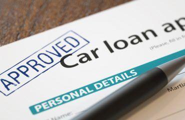 Car loan application with pen on it